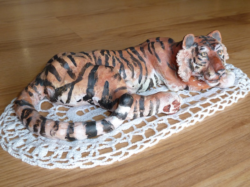 Tiger reclining, from tail