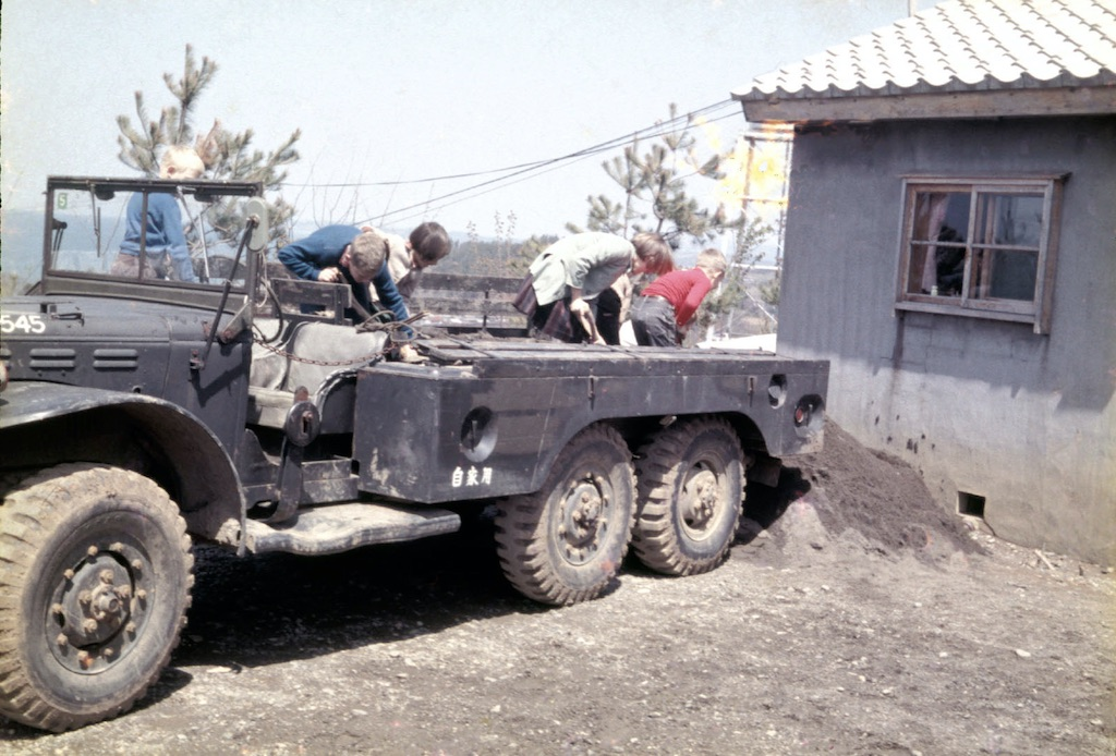 Army truck with dirt being shoveled out