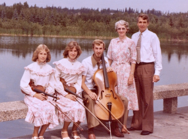 Grove family portrait by a lake with instruments