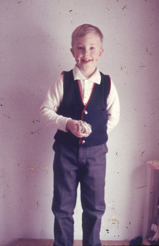 Young Larry dressed up with a vest
