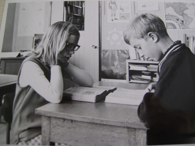 Larry and Marilyn studying at desk