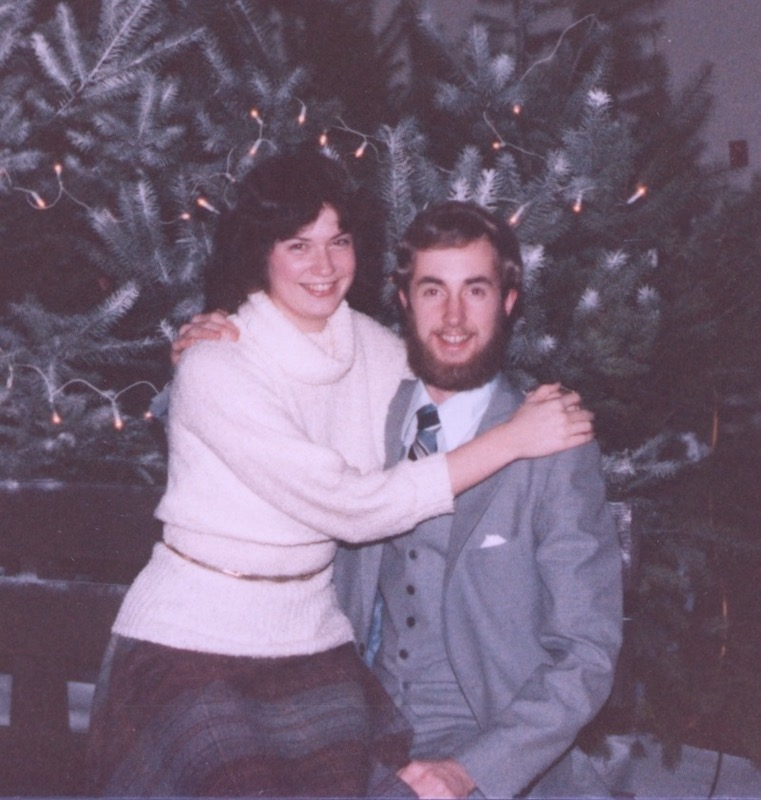 Larry and Melanie in front of a school Christmas tree
